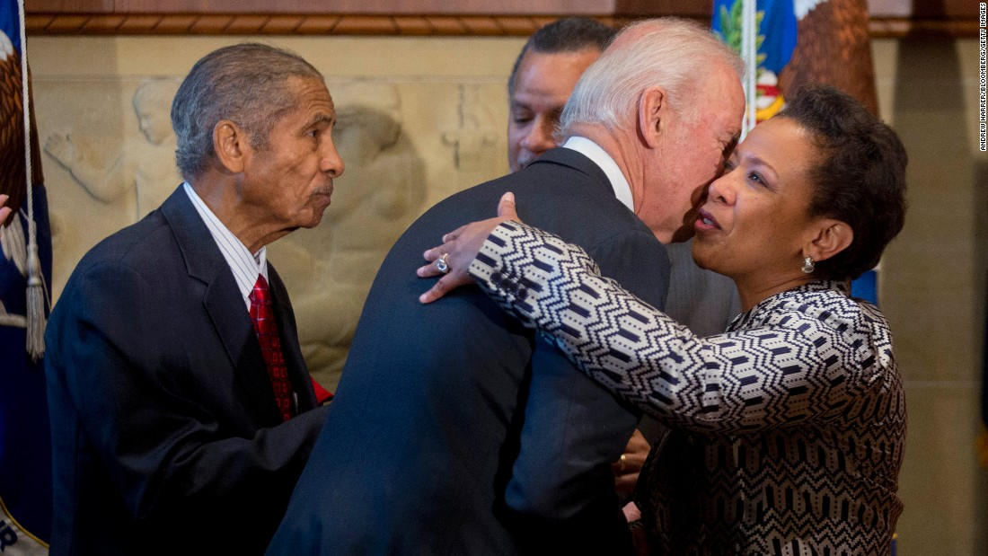 "U.S. Attorney General Loretta Lynch embraces Vice President Joe Biden after being <a href=""http://www.cnn.com/2015/04/23/politics/loretta-lynch-attorney-general-vote/"" target=""_blank"">sworn in as the 83rd U.S. attorney general</a> on Monday, April 27, at the Department of Justice in Washington. Lynch replaces Eric Holder. She is the country's first African-American woman to serve in the role, and her nomination was held up more than five months in the Senate."