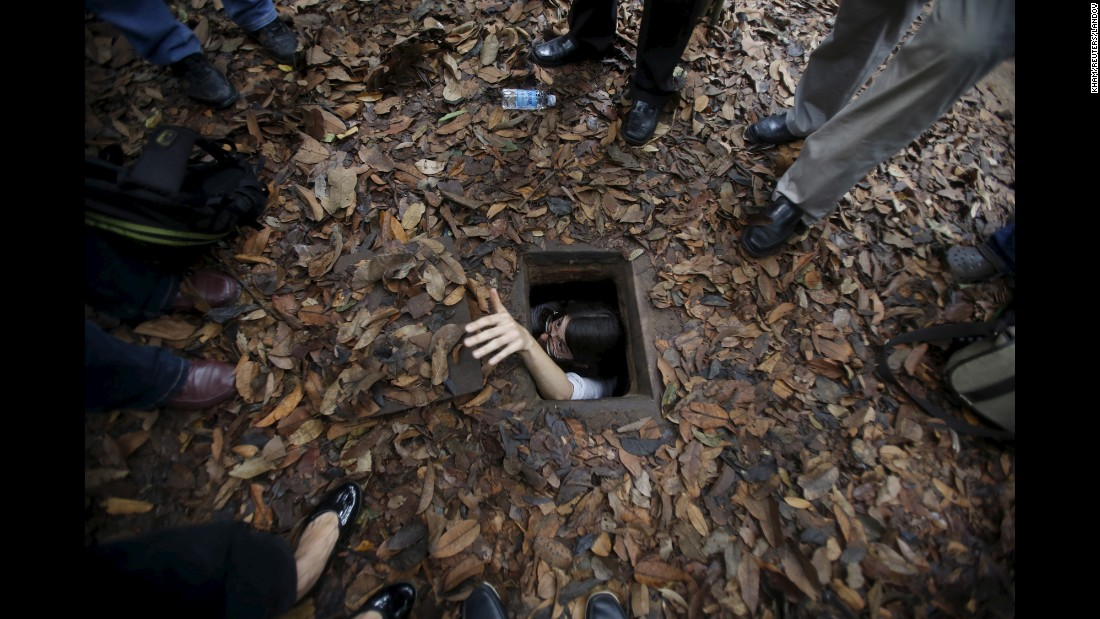 "A French journalist climbs into the Cu Chi tunnel network through a hole camouflaged on the jungle floor during a guided tour outside Ho Chi Minh City on Tuesday, April 28. The 124-mile underground tunnel network includes sections for living, dining, meeting and fighting and was used during the <a href=""http://www.cnn.com/2015/04/22/world/gallery/vietnam-war-timeline/index.html"" target=""_blank"">Vietnam War, which ended 40 years ago</a> on April 30. <a href=""http://www.cnn.com/2015/04/24/world/gallery/week-in-photos-0424/index.html"">See last week in 37 photos</a>"
