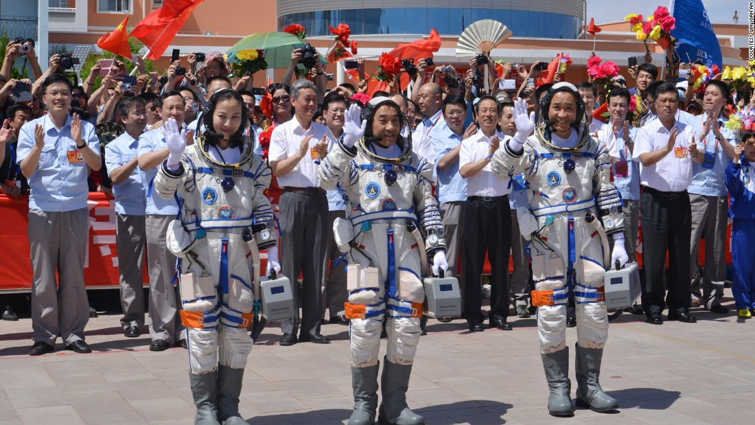 Nie, Zhang  and Wang wave to onlookers the day before the start of the mission. <br /><br />