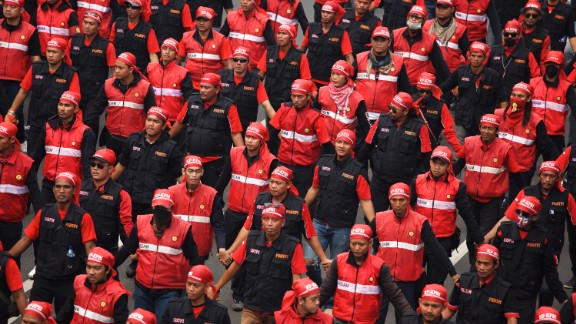 Labor union members join workers and activists in Jakarta, Indonesia. Protesters were demanding better working conditions.