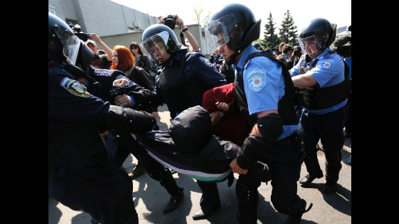 Police detain a man at the May Day rally  organized by the Communist Party of Ukraine in Kiev.