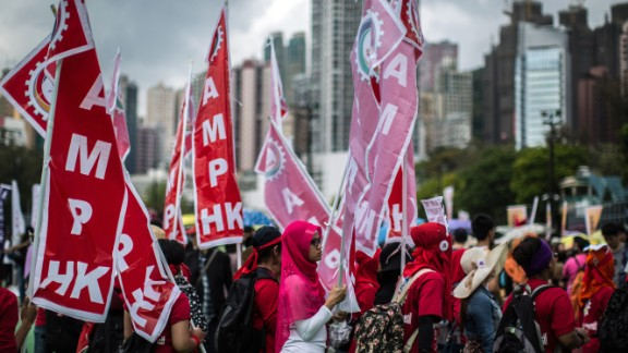 Migrant workers gather in Hong Kong to call for better working conditions for both local and migrant workers.