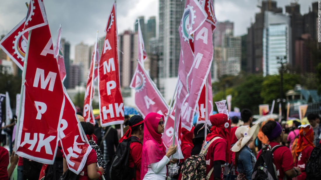 Migrant workers gather in Hong Kong to call for better working conditions.
