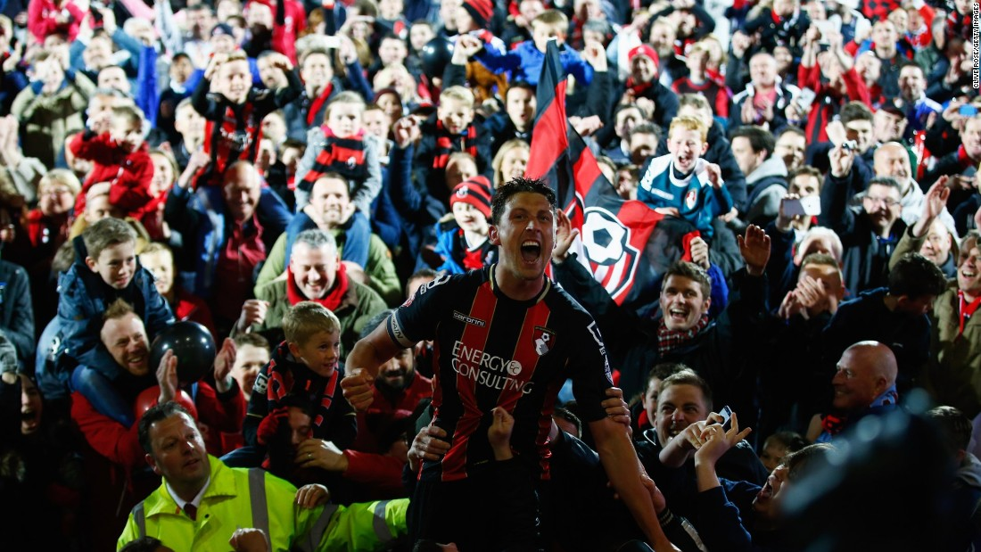 The team usually walk off the pitch but captain Tommy Elphick and other Bournemouth stars had to be carried off when promotion was secured.