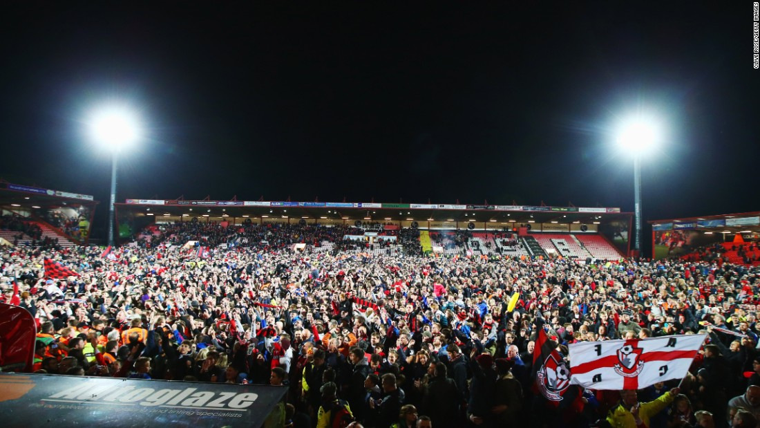 Bournemouth's victory against Bolton sparked a mass pitch invasion at the final whistle when the 125-year wait for top-flight football ended in jubilant fashion.