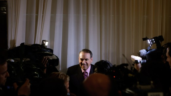 Huckabee is surrounded by supporters and members of the news media after talking about his new book,