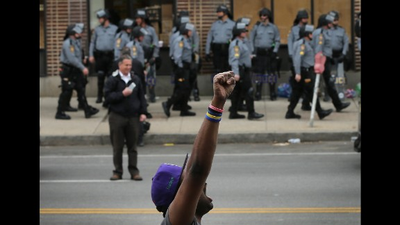 Baltimore residents celebrate after authorities released a report on the death of Freddie Gray on Friday, May 1, 2015.