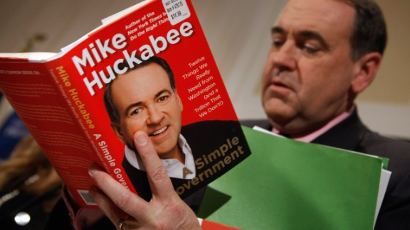 Former Gov. Mike Huckabee signs a copy of his new book, 'A Simple Government: Twelve Things We Really Need from Washington (and a Trillion that We Don't!),' at the National Press Club on February 24, 2011.