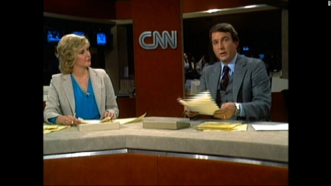 Happy birthday, CNN! The world's first 24-hour news network came to life on June 1, 1980. Husband-and-wife duo Lois Hart and Dave Walker anchored the first broadcast. Click through this gallery to see how the sets and graphics have changed. The following images are from around June of each year.