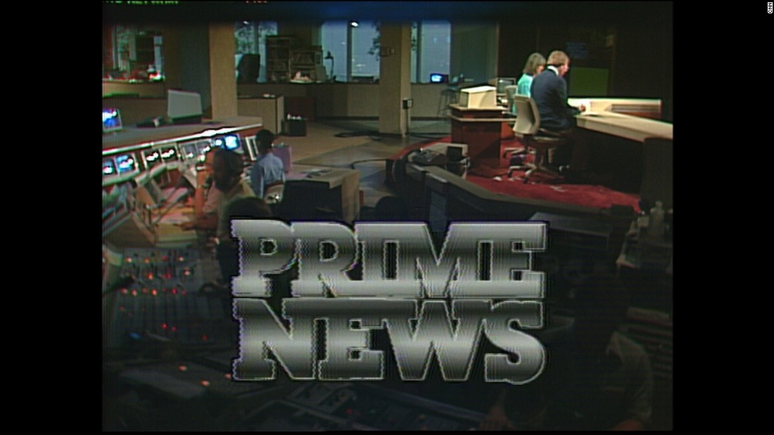 """CNN Prime News"" was a staple program in the '80s and '90s. Here, Lou Dobbs and Kathleen Sullivan prepare for a 1982 broadcast. The sunken area behind them, fondly known as ""the pit,"" is the control room."