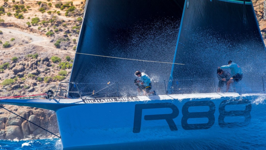 Crew members get a drenching as Rambler 88 cuts a path through the water during one of the four Maxi 1 class races off the coast of the Caribbean island of Saint-Barthelemy.