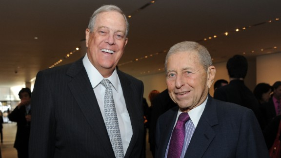 David Koch and Chairman of the Board and Chief Executive Officer of Transammonia Ronald P. Stanton attend the 2011 David Rockefeller Award Luncheon at The Museum of Modern Art on March 8, 2011 in New York City.