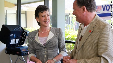 Fiorina, left, smiles with her husband Frank Fiorina, right, after casting their ballots at a polling place June 8, 2010 in Los Altos Hills, California.