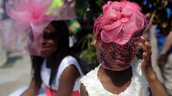 Two girls prepare for the Kentucky Derby on Saturday, May 2, 2015.