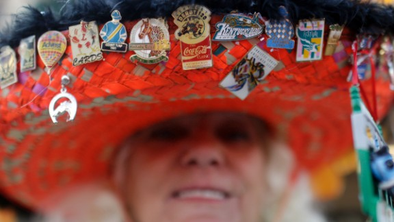 Ginny Keen adorned her hat with festive pins. While she's at the Derby, many hat makers were at parties around the country, vying for prizes for creativity.