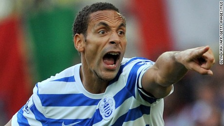 Queens Park Rangers' English defender Rio Ferdinand gestures during the English Premier League football match between West Ham United and Queens Park Rangers at The Boleyn Ground, Upton Park, in east London on October 5, 2014. AFP PHOTO/GLYN KIRK == RESTRICTED TO EDITORIAL USE. NO USE WITH UNAUTHORIZED AUDIO, VIDEO, DATA, FIXTURE LISTS, CLUB/LEAGUE LOGOS OR 'LIVE' SERVICES. ONLINE IN-MATCH USE LIMITED TO 45 IMAGES, NO VIDEO EMULATION. NO USE IN BETTING, GAMES OR SINGLE CLUB/LEAGUE/PLAYER PUBLICATIONS. == (Photo credit should read GLYN KIRK/AFP/Getty Images)