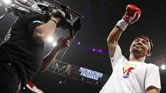 Manny Pacquiao acknowledges the crowd before the start of his welterweight world championship unification bout against Floyd Mayweather.