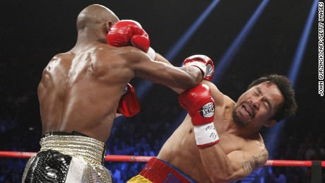 Floyd Mayweather Jr. and Manny Pacquiao exchange blows.