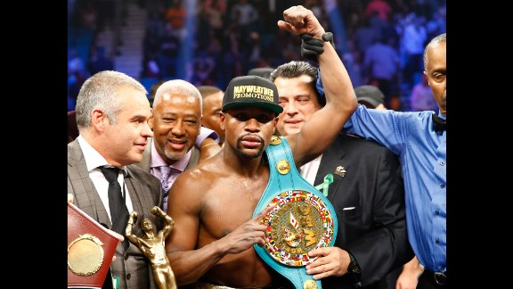 Mayweather celebrates his victory over Pacquiao. The bout went the full 12 rounds.