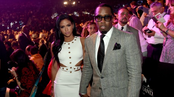 """Model Cassie Ventura, left, and Sean """"Diddy"""" Combs pose ringside."""