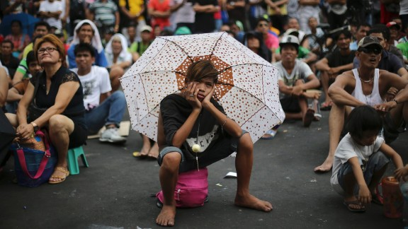 His face says it all. A boy watches a live satellite feed of the welterweight title fight between Filipino boxing hero Manny Pacquiao and Floyd Mayweather Jr.  The mayor of Manila set up free outdoor screenings for crowds in parks and sports stadiums on May 3.  Pacquiao lost.