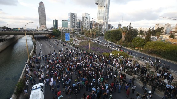 Protesters block the Ayalon freeway in Tel Aviv during the demonstration.