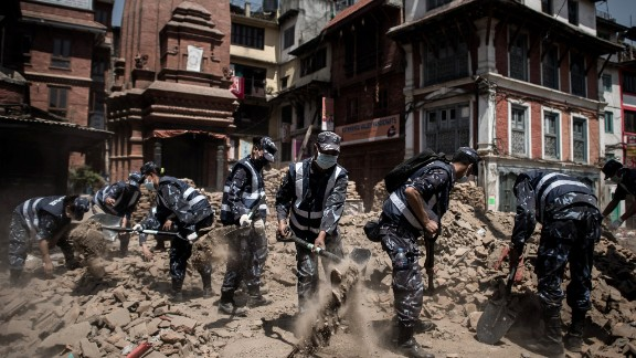 Nepalese police officers clear debris from Durbar Square in Kathmandu on Sunday, May 3. A magnitude-7.8 earthquake centered less than 50 miles from Kathmandu rocked Nepal with devastating force Saturday, April 25. The earthquake and its aftershocks have turned one of the world