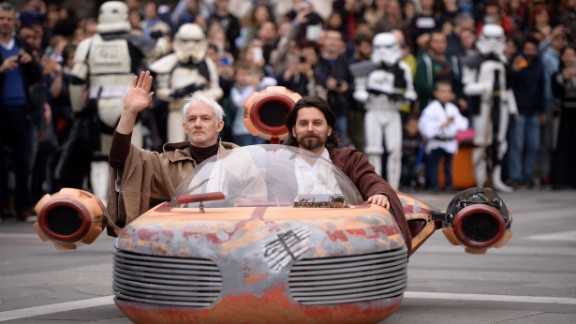 """Cosplayers dressed as """"Star Wars"""" characters Obi Wan Kenobi and Anakin Skywalker attend a """"Star Wars"""" Day event in Milan, Italy, on May 3, as fans get a jump on celebrating """"Star Wars Day."""""""