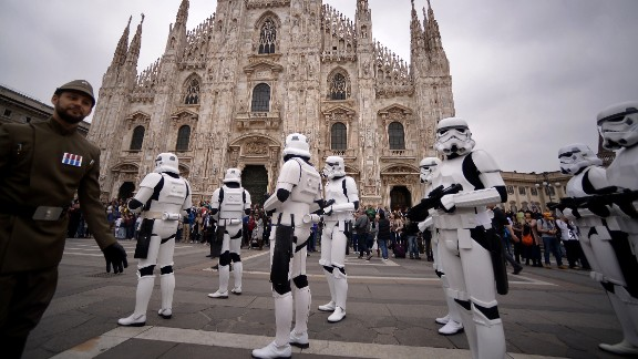 """""""Star Wars"""" fans dressed as stormtroopers stand in front of Milan's Duomo on May 3."""