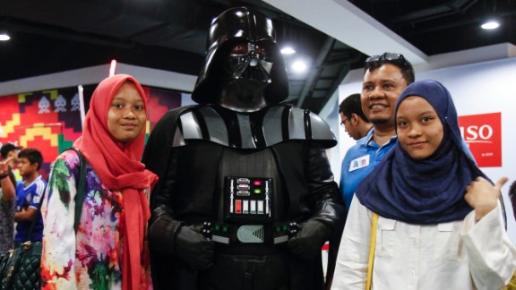 Malaysians pose for a souvenir photograph with Darth Vader in Kuala Lumpur, Malaysia, on May 2.