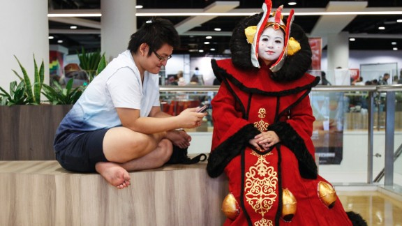 """""""Star Wars"""" fan Michelle Chee, right, dressed as Padme Amidala takes a rest during the """"Star Wars Day"""" gathering in a mall downtown Kuala Lumpur, Malaysia, on May 2."""