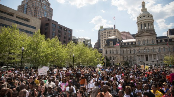 People attend a rally lead by faith leaders in front of Baltimore's city hall calling for justice in response to the death of Freddie Gray on Sunday May 3.