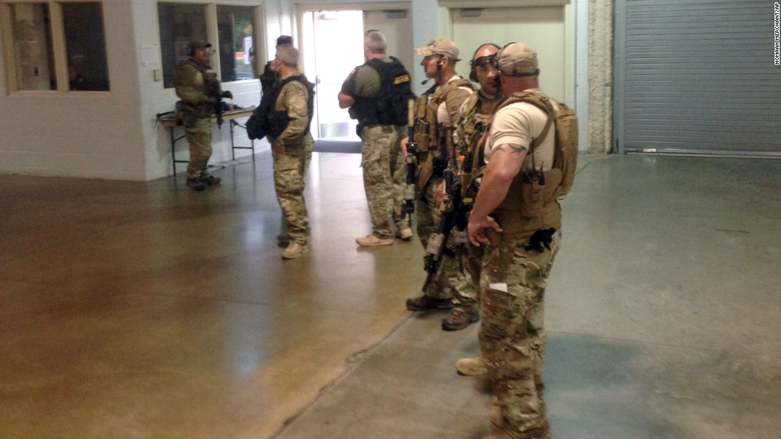 Members of the Garland Police Department stand inside the Curtis Culwell Center.