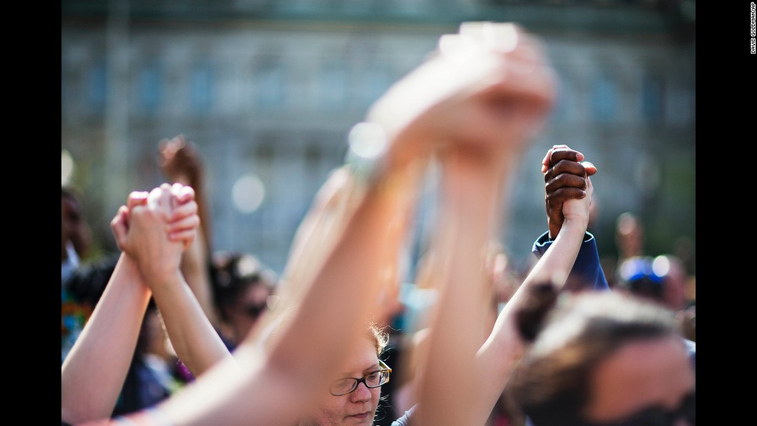 "People hold hands during a rally at Baltimore City Hall on Sunday, May 3. The death of Freddie Gray, who died in police custody, sparked rioting in Baltimore and protests <a href=""http://www.cnn.com/2015/04/30/us/gallery/freddie-gray-protests-across-us/index.html"" target=""_blank"">across the country</a>."