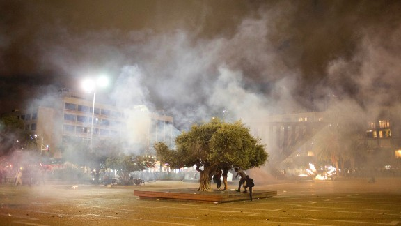 """Protesters in Tel Aviv clash with Israeli riot police during the May 3 protest against racism and police brutality. The protest was mostly peaceful during the day, but it became violent by nightfall. At least 20 officers were hurt and """"multiple protesters"""" were arrested, police spokesman Micky Rosenfeld said."""