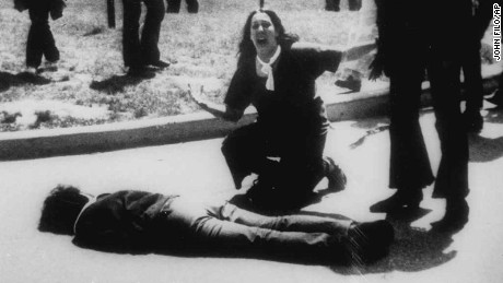 "*** FILE *** Mary Ann Vecchio gestures and screams as she kneels by the body of a student lying face down on the campus of Kent State University, Kent, Ohio on May 4, 1970. A static-filled recording was released Tuesday May 1, 2007 of the 1970 Kent State University shooting that killed four students raising questions not only about whether someone called on National Guardsmen to fire, but also who might have given the order. The tape was released by Alan Canfora, 58, one of nine students wounded in the 1970 shootings. He played two versions of the tape _ the original and an amplified version _ in which he says a Guard officer issues the command, ""Right here! Get Set! Point! Fire!""  (AP Photo/John Filo)"