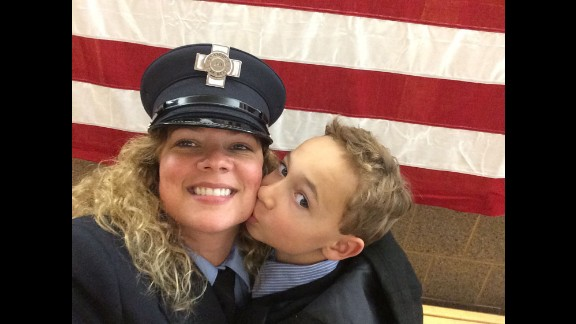 """Moms share their everyday triumphs in parenting. """"In 2014, I completed the Massachusetts Fire Academy for the city of Cambridge, in which I grew up. I am a 42-year-old divorced mother with custody of my son. My proudest moment was being able to have my son pin my badge on my uniform during the badge ceremony for the city."""" -- Stephanie Crayton, Cambridge, Massachusetts"""