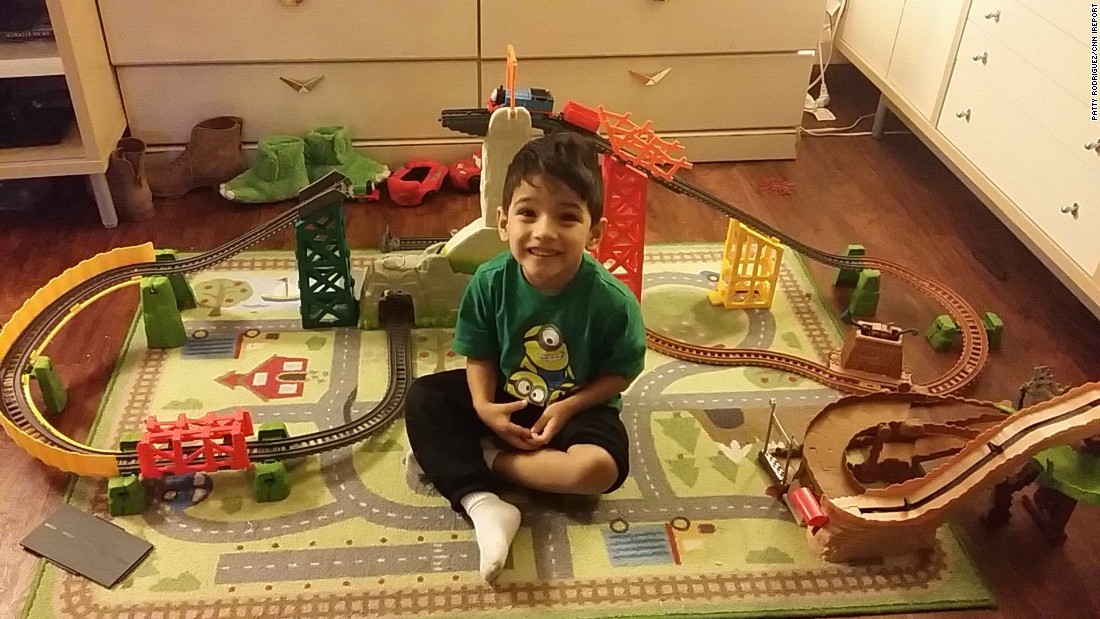 """I would never have guessed that putting together a train track would be so difficult. I was very proud of myself, not only because I didn't rip all my hair out, but because I gave Jay the best gift ever -- patience. He even wanted to take a picture in front of it before he played!"" -- Patty Rodriguez, Des Plaines, Illinois"