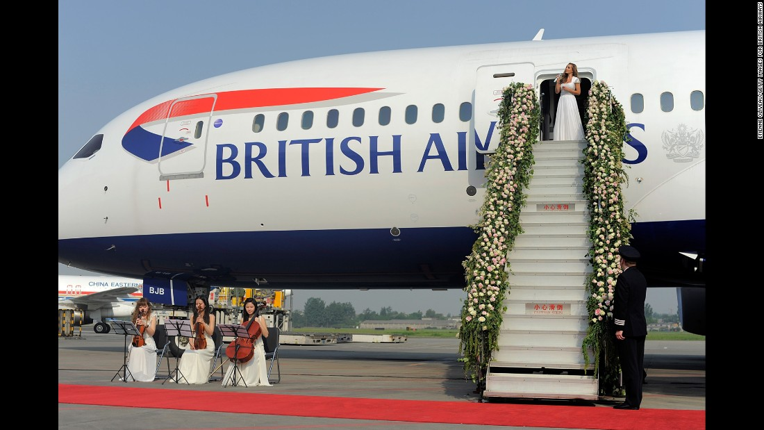 "Mezzo-soprano Katherine Jenkins performs the Leonard Cohen classic ""Hallelujah"" on the flower-adorned steps of British Airways' new Boeing 787 Dreamliner to celebrate the inaugural flight from London Heathrow Airport to China's Chengdu International Airport on May 6, 2014."