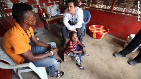 Orlando Bloom visits Ansu Turary and his son Abraham, who are the only remaining members of their family, due to the Ebola outbreak.