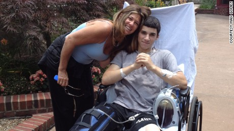 Max Gomez, with mom Doreen, recovers after his right leg was amputated following a motocross accident.