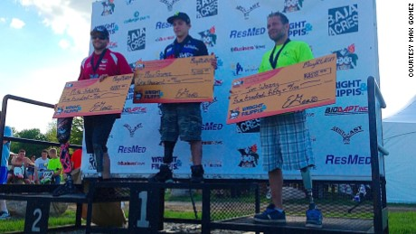 Gomez wins the 2014 Extremity Games for athletes with disabilities. Mike Schultz, left, was an inspiration.