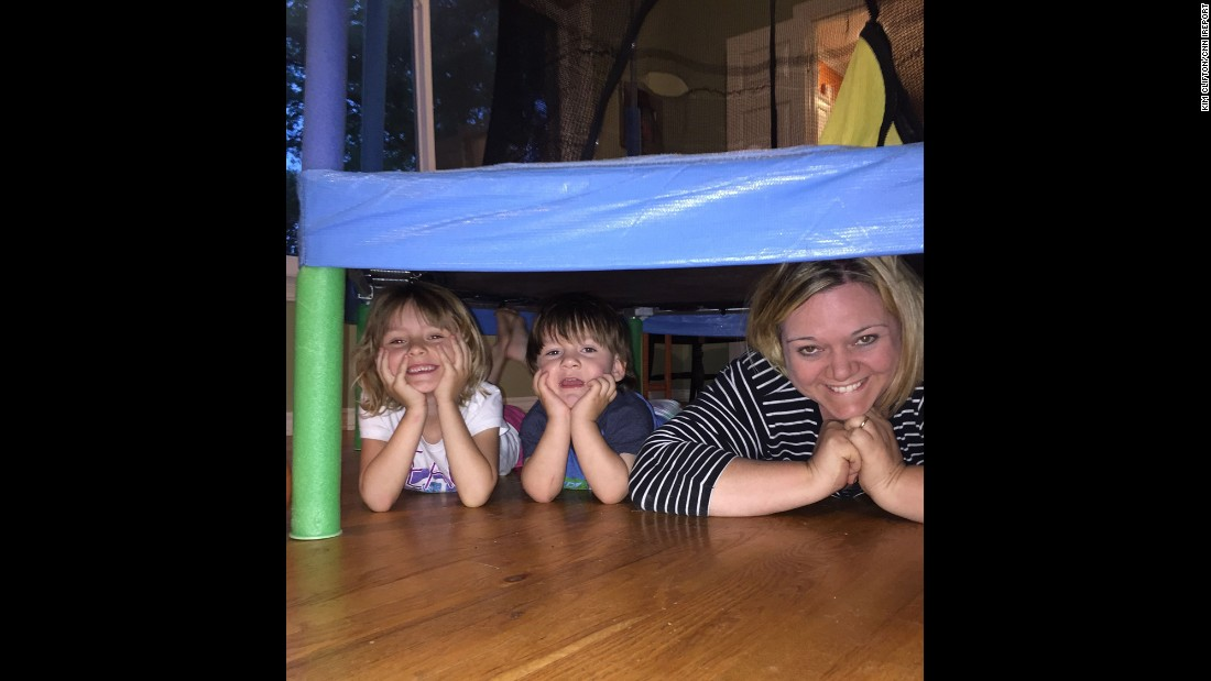 """We were teaching my 2-year-old son to play hide and seek. He liked our hiding place and decided to join us. ...  I frequently have to remind myself to slow down and enjoy this time with them. This day I got it right and we had some memorable fun."" -- Kim Clifton, Tulsa, Oklahoma"