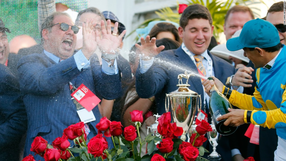 "Jockey Victor Espinoza celebrates his third Kentucky Derby win by spraying Ahmed Zayat, owner of American Pharaoh, with champagne on Saturday, May 2, in Louisville, Kentucky. American Pharoah, the betting favorite all week, <a href=""http://www.cnn.com/2015/05/02/sport/kentucky-derby-american-pharoah/index.html"">won by one length</a>, outracing Firing Line to the finish line in front of a record crowd at Churchill Downs."