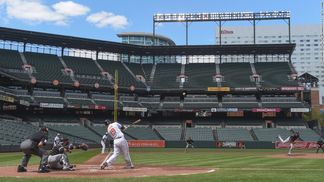 "Orioles first baseman Chris Davis hits a three-run home run in the bottom of the first inning to an empty Oriole Park in Baltimore, on Wednesday, April 29. <a href=""http://www.cnn.com/2015/04/29/us/gallery/white-sox-orioles-baseball/index.html"">The baseball game</a> was played in a stadium closed to the public after the <a href=""http://www.cnn.com/2015/04/23/us/gallery/freddie-gray-protest/index.html"">protests in the city turned to riots</a> last week."