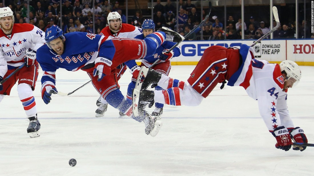 James Sheppard of the New York Rangers, left, is hit by Brooks Orpik of the Washington Capitals during the 2015 NHL Stanley Cup Playoffs on Saturday, May 2, in New York.