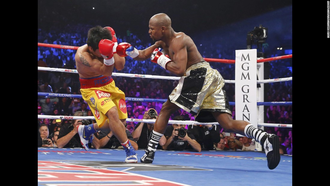Manny Pacquiao covers his face as Floyd Mayweather Jr. punches during the first round in Las Vegas on Saturday, May 2.