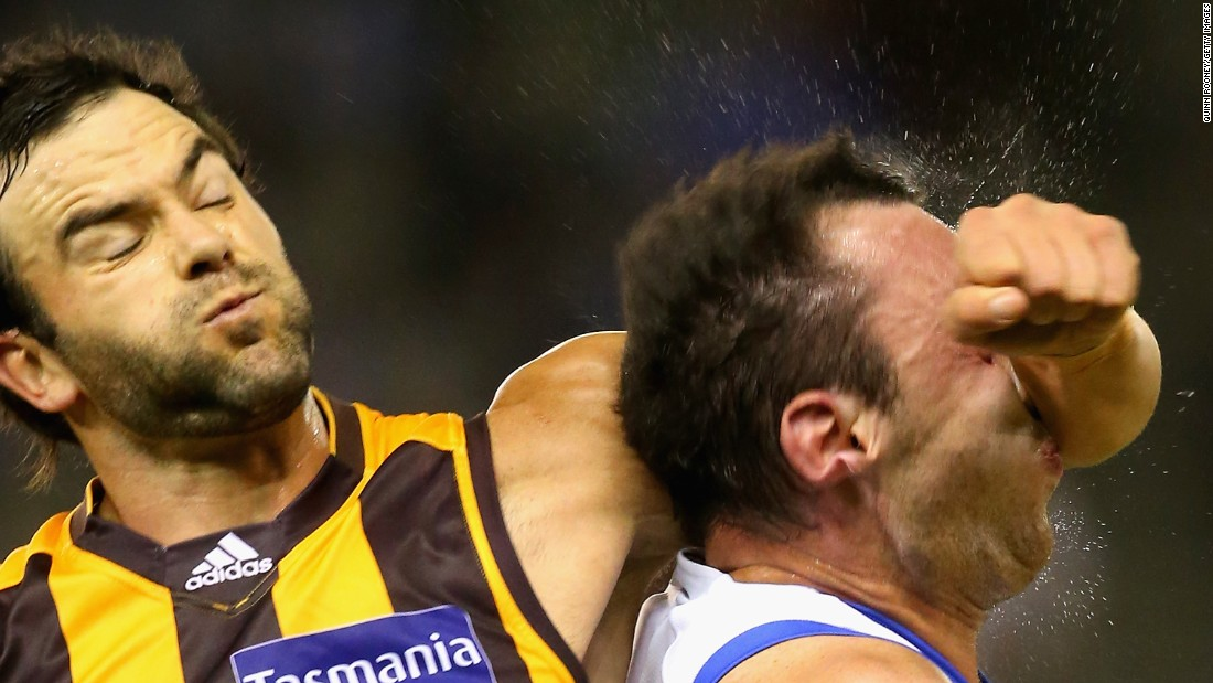 Jordan Lewis of the Hawks hits Todd Goldstein of the Kangaroos as he fights for possession of the ball during an Australian rules football match on Saturday, May 2, in Melbourne.