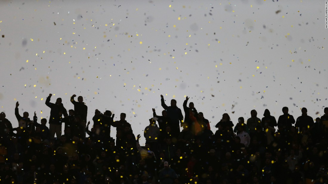 Boca Juniors fans cheer for their team during a tournament soccer match against River Plate in Buenos Aires on Sunday, May 3.