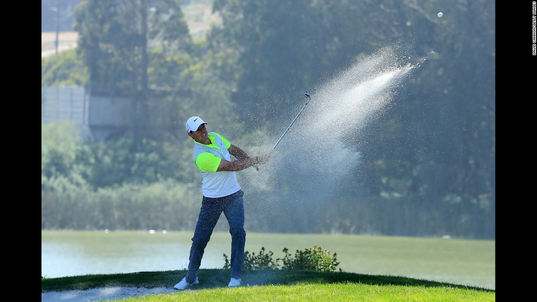 Northern Ireland's Rory McIlroy hits from a bunker on the 12th hole on Thursday, April 30, during the World Golf Championship Cadillac Match in San Francisco.
